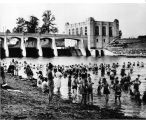 Municipal Beach, Fort Wayne: now city utilities, showing swimmers, 1930s, west of St. Joseph River dam, with dam and utilities building in background.