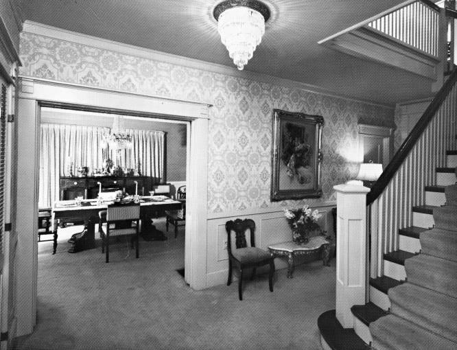 HOME OF WILLIAM R ROCKHILL 1710 FOREST PARK BLVD FORT WAYNE INTERIOR HALL LOOKING INTO DINING ROOM INCLUDES STAIRCASE WITH RAILING CHAIRS TABLES