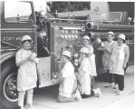 Fort Wayne Firemen's Wife's Auxiliary Coffee Team. L-R: Mrs. Robert Soest, Edward Buechner on...