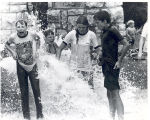 Children cooling off at North Anthony Blvd. and Niagara Drive in a stream of water from a fire...