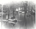 Flood of 1978 in Fort Wayne, IN. Daniel Matter and Donald Baker in boat. Date 03/21/1978.