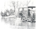 Flood of 1978 in Fort Wayne, IN. John Gillispie and Michael Lauer next to Pumper No. 209 at the...
