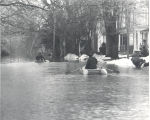 Flood of 1978 in Fort Wayne, IN. Donald A. Weber in the back of the canoe on Greenwood Ave. off...