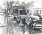 Flood of 1978 in Fort Wayne, IN. Greenwood Ave. off West Main Street. Donald A. Weber getting...