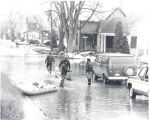 Flood of 1978 in Fort Wayne, IN. Greenwood Ave. off West Main Street. Donald A. Weber pulling...