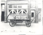 1848 Button Hand Pumper at the rear of Fire Station No. 1, 319 East Main Street. The button came...