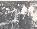 1955 American LaFrance Pumper. L-R: William George, Robert Kern, Richard Fetters. No Date.