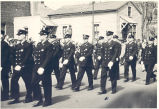 During the 1940's the Fort Wayne Fire Department had a marching patrol. Here they are marching in...