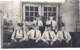 Fire Station No. 2, 436 East Wallace Street. Firemen seated in front of door leading out to...