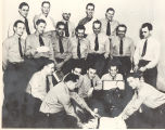 First Aid Class for the WWII vets as part of their rookie training. Front L-R: Raymond Subzda,...