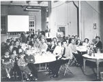 Firemen host their families for Christmas Dinner at Fire Station No. 1, 319 East Main Street. Left...