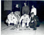 Fort Wayne J.C's painting fire department phone number 119 on city sidewalks. L-R: Chas. Foster,...