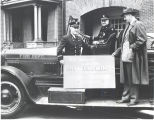 Fire Chief Clinton Baals, Master Mechanic Herbert Foster and Mayor Robert Meyers on 1926 Seagrave...
