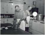 Firemen in the kitchen at Fire Station No. 1, 319 East Main Street. L-R: Captain Alfred Dautz and...