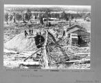 Deadwood Dump on Gold Run, Martin, Clark & Edward. Shows log shacks with logs and lumber,...