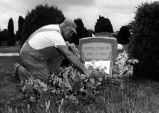 CARETAKER AT GRAVE OF JAMES DEAN; FAIRMOUNT, INDIANA (NEAR MARION).