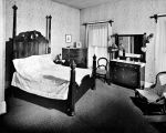 A BEDROOM IN THE HAYDEN (FORMERLY HANNA) HOUSE. SHOWING BED WITH APPLIQUE COVERLET, CHESTS OF...