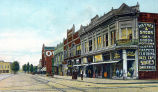 LOOKING SOUTH ON MAIN STREET, TIPTON IN: COLORED POSTCARD SHOWING HAYNES & SHOOK DRY GOODS, DR...