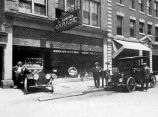 AUBURN AUTOMOBILE COMPANY, FORT WAYNE IN: EXTERIOR SHOWING TWO AUTOS. FOUNDED 1912, PHOTO FROM...