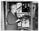 Allen County Fort Wayne Historical Society: woman examining exhibits.