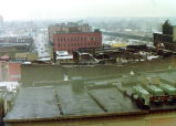 Fort Wayne IN: view over roofs in the Landing area after the fires of 3-4 February 1975. Roof of...