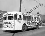 Fort Wayne Transit: showing bus decorated to promote David Auto and the 1955 Pontiac. September...