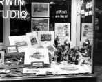 Fort Wayne Transit: display window for Transit Progress Week, 24-30 September 1951, window of Erwin Studio, showing pictures of old transit vehicles and display of cameras
