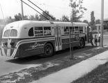 Indiana Service Corporation: showing passengers boarding trolley coach, side view. Original has...