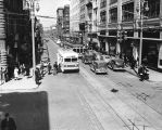 Calhoun Street, Fort Wayne IN: looking north from Washington, with trolley coach stopped for...
