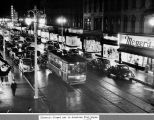 Calhoun Street, Fort Wayne IN: on a wet night, showing streetcar in center of picture and Meyer's...