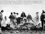 Arlington Ind. April 24: Grim Task: Coroner's deputies and authorities sort debris from a...