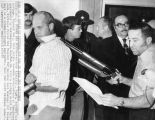 Anthony Kiritsis marches his hostage, Richard Hall, into police command headquarters at Crestwood...
