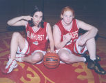 2 GIRL BASKETBALL PLAYERS