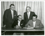 Central District Convention, Fort Wayne, Ind. 1957. Signing the Constitution of Synod. Standing:...