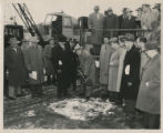 Mayor Harry W. Baals turning first shovelful of dirt at groundbreaking.  Capt. Custer Dunifon,...