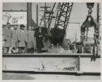 Raising of first beam for project.  This was at Harrison St.;  Left to right, upper level: City...